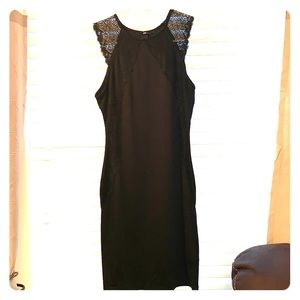 Black bodycon dress with lace detailing